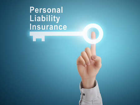 liability insurance: male hand pressing personal liability insurance key button over blue abstract background