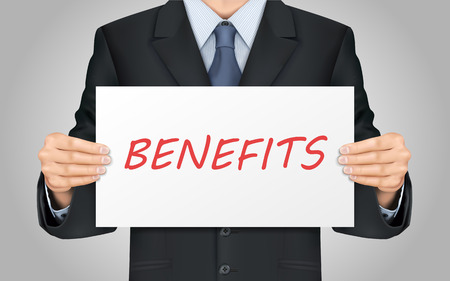 compensate: close-up look at businessman holding benefits word poster