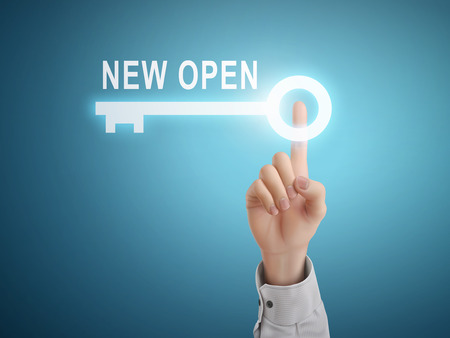 inauguration: male hand pressing new open key button over blue abstract background