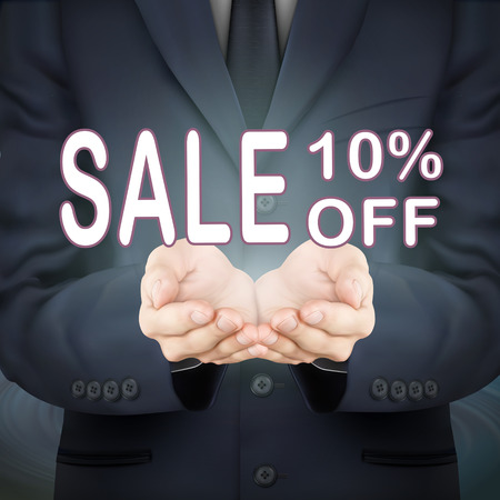 advertisements: close-up look at businessman holding sale 10 percent off words