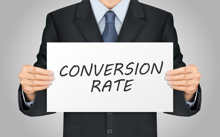 conversion: close-up look at businessman holding conversion rate words poster