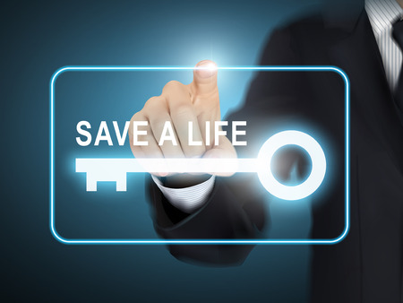 cpr: male hand pressing save a life key button over blue abstract background
