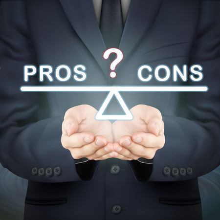 cons: close-up look at businessman holding pros and cons seesaw