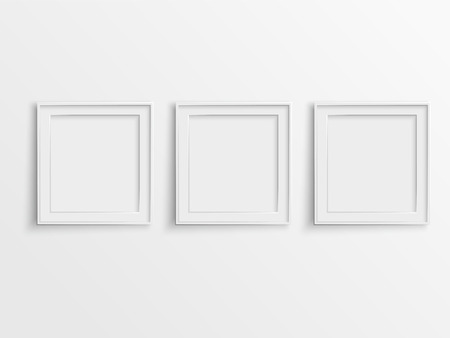 frame wall: blank photo frames hanging on the wall