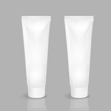 grey background: blank cosmetic tubes isolated on grey background