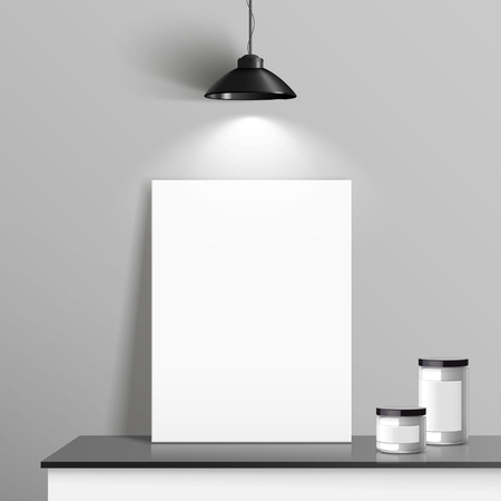 blank canvas: elegant blank canvas placed on cupboard with illumination over grey wall