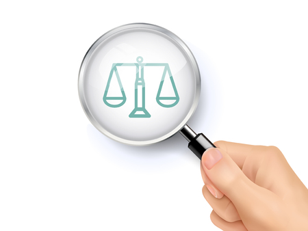 government: scales of justice icon showing through magnifying glass held by hand