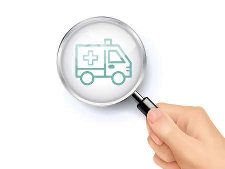 hand held: ambulance icon showing through magnifying glass held by hand
