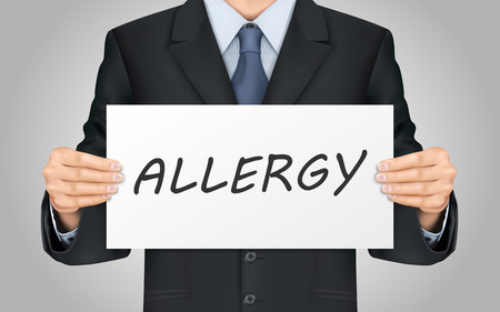 allergic reactions: close-up look at businessman holding allergy poster