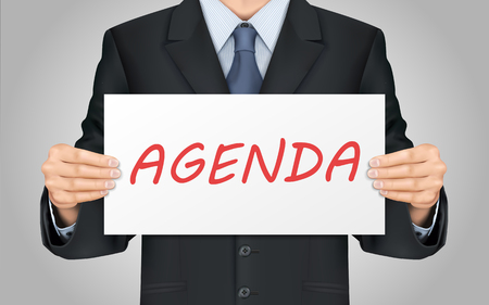 agenda: close-up look at businessman holding agenda poster