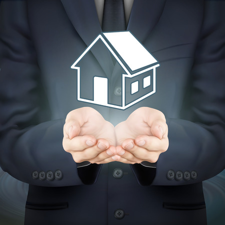 holding hands: close-up look at businessman holding real estate icon Illustration