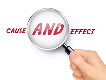 cause and effect: cause and effect words showing through magnifying glass held by hand