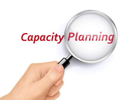 capacity: capacity planning words showing through magnifying glass held by hand