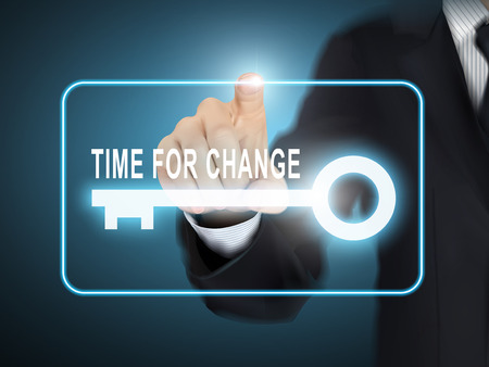 male hand pressing time for change key button over blue abstract background