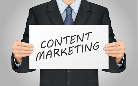article of clothing: close-up look at businessman holding content marketing poster
