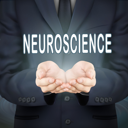 neuroscience: close-up look at businessman holding neuroscience word