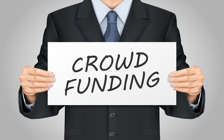 crowd sourcing: close-up look at businessman holding crowd funding poster