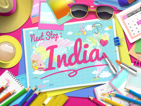 adventurer: India on map, top view of colorful travel essentials on table
