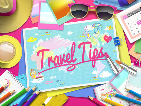 Travel Tips on map, top view of colorful travel essentials on table