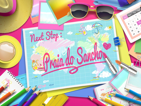 praia: Praia do Sancho on map, top view of colorful travel essentials on table