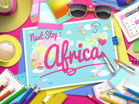 adventurer: Africa on map, top view of colorful travel essentials on table