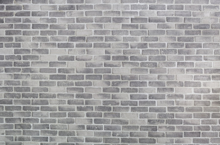 Old grey brick wall for background or texture Banco de Imagens
