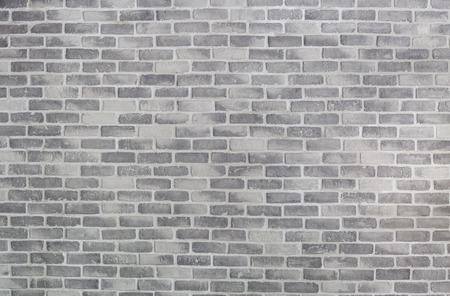 Vieja pared de ladrillo gris para el fondo o la textura