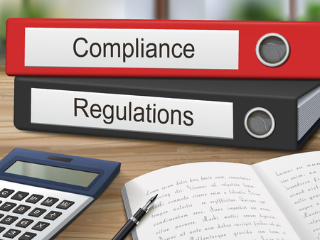 compliant: compliance and regulations binders isolated on the wooden table. 3D illustration.