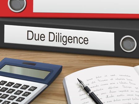 due diligence binders isolated on the wooden table. 3D illustration.