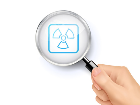 radium: Radiation icon sign showing through by magnifying glass held by hand. 3D illustration. Illustration