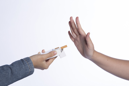 No smoking sign, a hand refusing cigarette offered by others for health reason