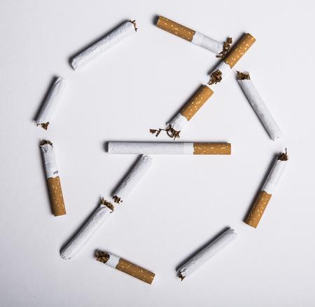 No smoking concept, top view of no smoking sign made with broken cigarettes