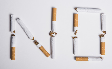 No smoking concept, top view of no word made with broken cigarettes