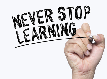 never stop learning  written by hand, hand writing on transparent board, photo