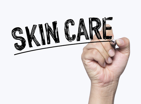 skin care written by hand, hand writing on transparent board, photo Stock Photo