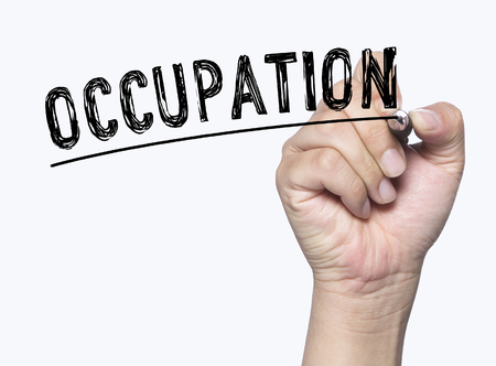 photo board: occupation written by hand, hand writing on transparent board, photo Stock Photo