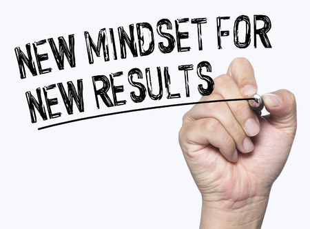 mindset: new mindset for new results written by hand written by hand, hand writing on transparent board, photo