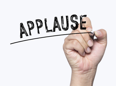 applause written by hand, hand writing on transparent board, photo Stock Photo