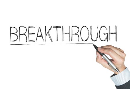 to break through: break through written by hand, hand writing on transparent board, photo