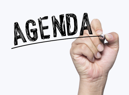 photo board: agenda written by hand, hand writing on transparent board, photo