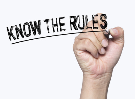 know the rules written by hand, hand writing on transparent board, photo