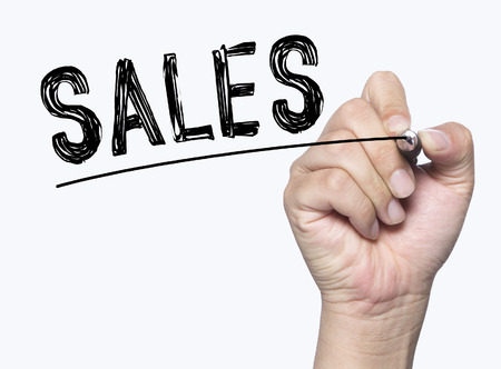 sales written by hand, hand writing on transparent board, photo