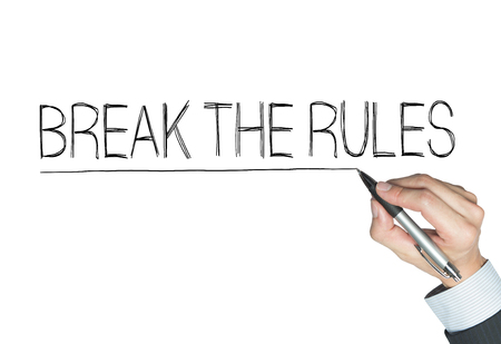 break the rules: break the rules written by hand, hand writing on transparent board, photo
