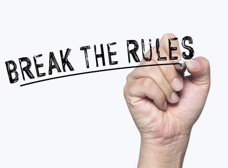 break: break the rules written by hand, hand writing on transparent board, photo