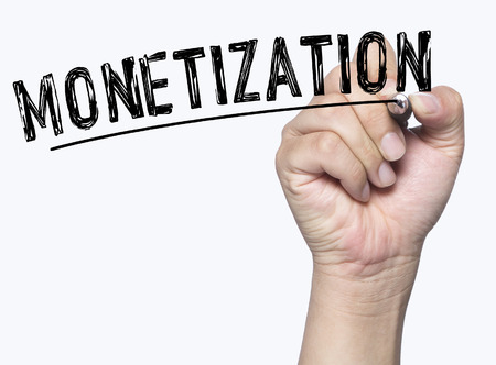 monetization: monetization written by hand, hand writing on transparent board, photo