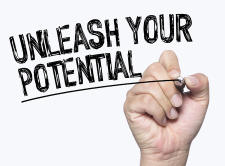 unleash: unleash your potential  written by hand, hand writing on transparent board, photo