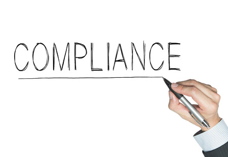 compliance written by hand, hand writing on transparent board, photo