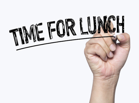 time for lunch written by hand, hand writing on transparent board, photo