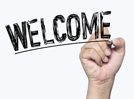 presentation: welcome written by hand, hand writing on transparent board, photo Stock Photo