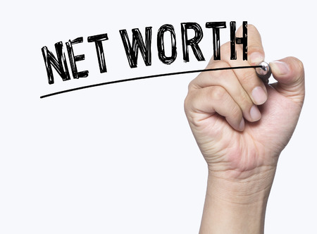 net worth written by hand, hand writing on transparent board, photo Stock Photo